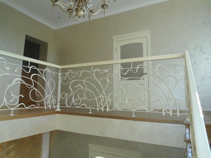 Особенности выбора кованых перил для оригинальной лестницы