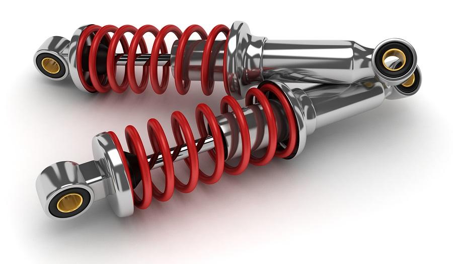 Какие амортизаторы выбрать для автомобиля: жидкостные или газовые?