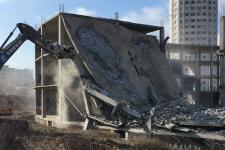 Способы демонтажа зданий в городе